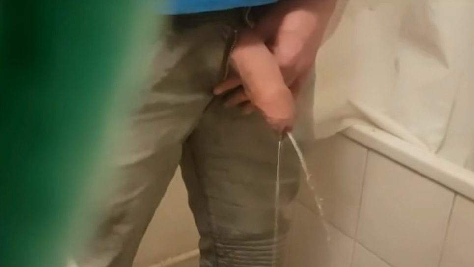 Guy tries to piss with a big semi-hard cock